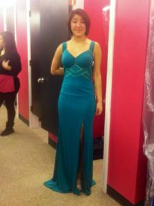 Maren Sanchez shows off the dress she was going to wear to prom today.