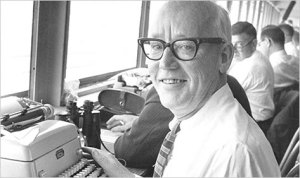 Red Smith, hard at work, covering horse racing. (Photo courtesy of the NYRA).