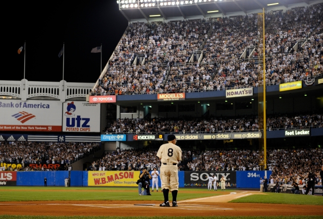 File- This Sept. 21, 2008, file photo shows former New York Yankees player Yogi Berra at home plate at Yankee Stadium in New York before the Yankees play the Baltimore Orioles in the final regular season baseball game at the stadium. Berra, the Yankees Hall of Fame catcher has died. He was 90. (AP Photo/Ed Betz, File)