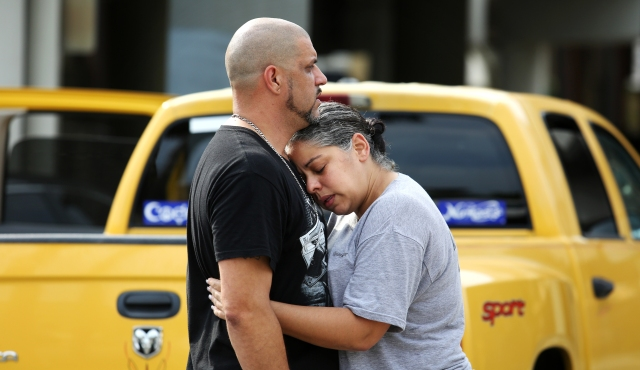 Ray Rivera, left, a DJ at Pulse Orlando nightclub, is consoled by a friend, outside of the Orlando Police Department after a shooting involving multiple fatalities at the nightclub, Sunday, June 12, 2016, in Orlando, Fla. (Joe Burbank/Orlando Sentinel via AP)