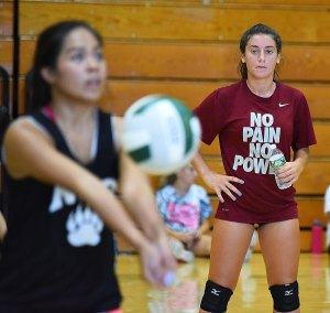 Norwalk High's Edona Jakaj, right, is a senior leader for her volleyball team, even though she's not a captain.
